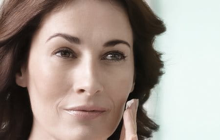Woman applies Eucerin Volume-Filler Night Care on her face