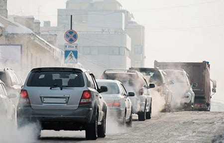 Photograph of cars and exhaust fumes.