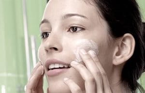 Image of woman applying Eucerin Toner to her face